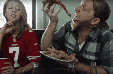 Woman watching the Super Bowl with her boyfriend