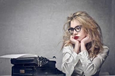 Woman with writer's block at a typewriter