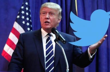 Donald Trump holding Twitter icon in his hand at a podium