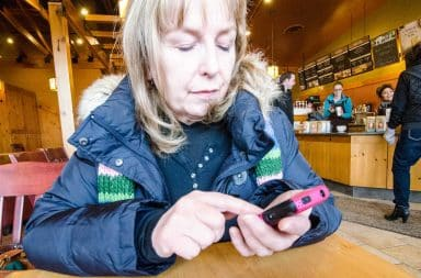 Mom texting in a coffee shop