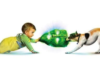 Son of the Mask baby and dog tug of war on a green mask