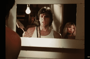 Rick Springfield looks at himself more than the girl he claims to love