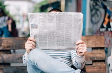 A man reads the paper.