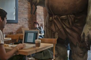 Giant in a coffee shop, using all the wifi