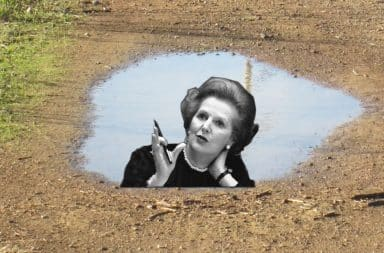 Margaret Thatcher's reflection in a rain puddle
