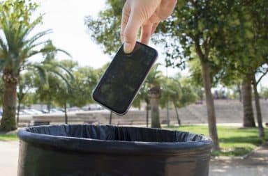 The phone goes in the trash