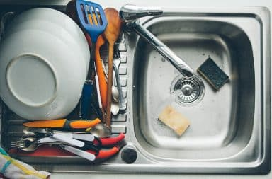 utensils in the sink, being dirty
