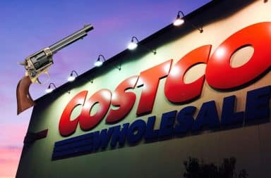 Costco Wholesale sign at night with a gun on it