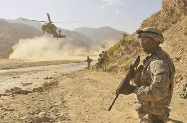 Afghanistan War trooper with gun in desert