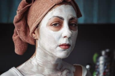 Woman with a white face mask for dry skin
