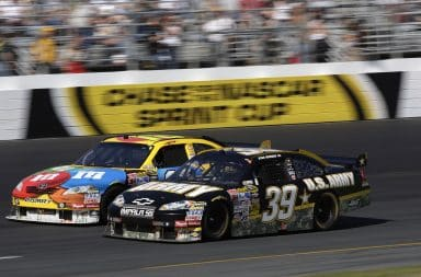 Two NASCAR race cars on an oval track