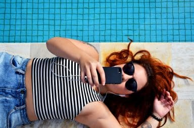 Boring woman on the phone by the pool