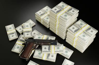 money and gun for the mob guys
