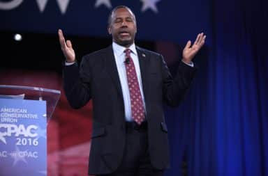 Ben Carson hands up in the air
