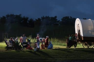 Amish party games at night by the wagon