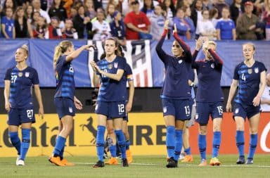 USWNT players on the soccer pitch