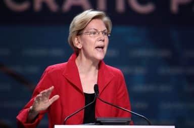 Elizabeth Warren speaking at a podium
