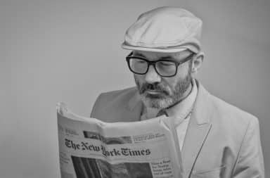 Man reading The New York Times paper