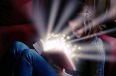 Maiden reading a magical book