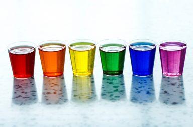 Multi-colored liquids in shot glasses