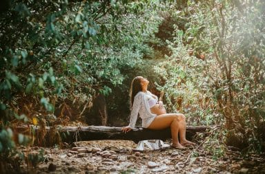Pregnant woman in the woods