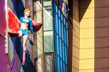Superwoman on a building side