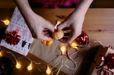 Wrapping an orange as a Christmas gift