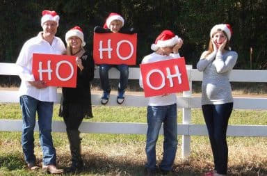 Santa hats on a fence outside