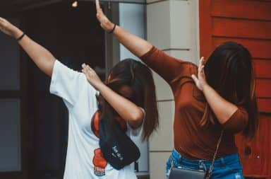 Two women dabbing