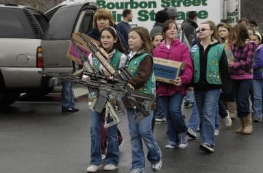 Girl Scouts selling cookies and guns
