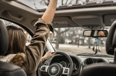Woman with road rage and her hand out of the sunroof