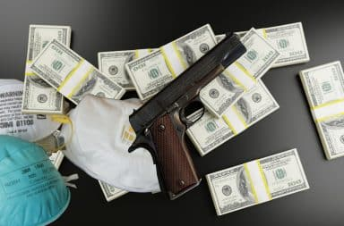 money guns and masks