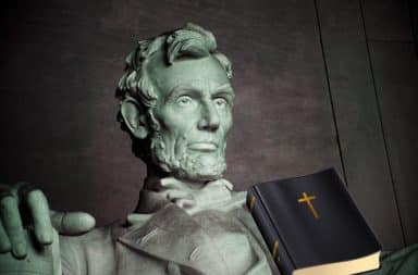 Abe Lincoln statue with the BIble