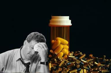 Stressed out man and a pill bottle