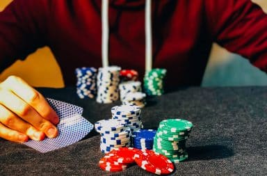 Poker professional player at a card table