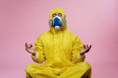 Man in hazmat suit meditating
