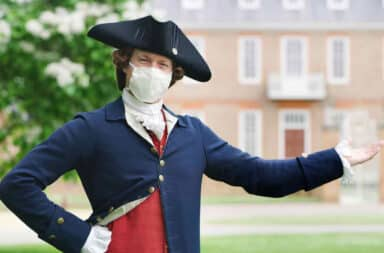 Colonial Williamsburg re-enactor wearing a face mask