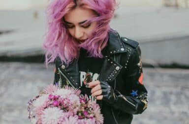Leather jacket on a woman with purple hair
