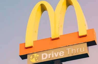 McDonald's drive-thru sign with arches