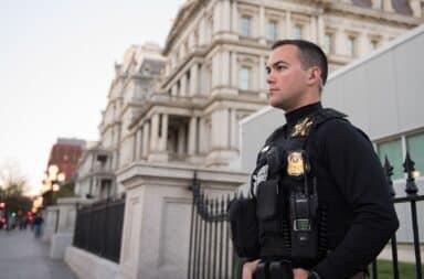 Secret Service armed guard with bulletproof vest