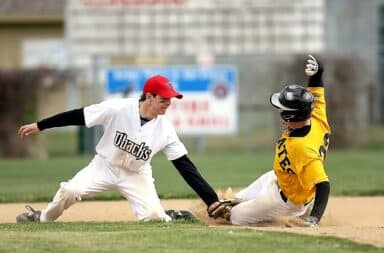 Baseball tagging someone out at second base