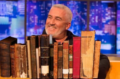 Paul Hollywood with a lot of books