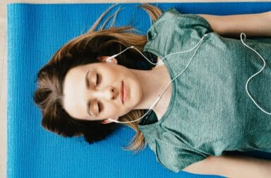 Woman listening to music with headphones on