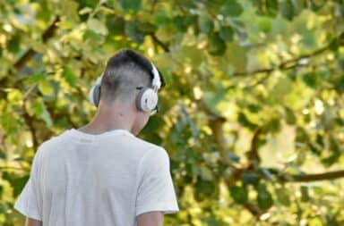 guy listening to music outside