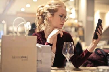 lady with wine and phone