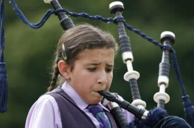 girl playing bagpipes