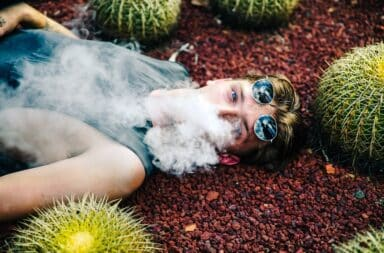 Man vaping next to cacti