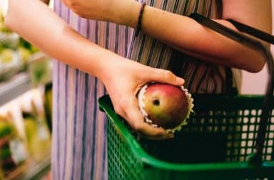 grocery hand basket with apple