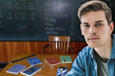 guy school in front of chalkboard