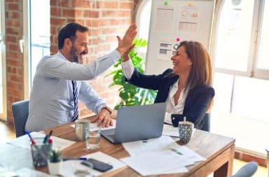 High five in a biz meeting